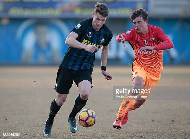 Andrea Pinamonti of FC Internazionale Milano competes for the ball with Luca Pellegrini of As Roma during the Primavera Tim Cup juvenile match...