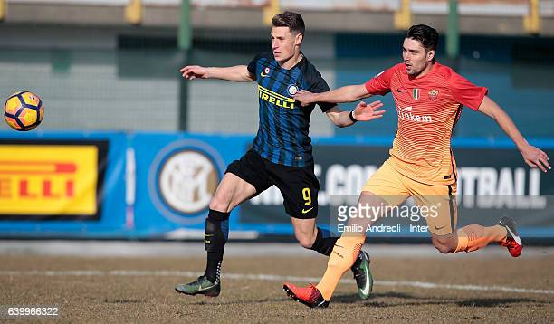 Andrea Pinamonti of FC Internazionale Milano competes for the ball with Riccardo Marchizza of As Roma during the Primavera Tim Cup juvenile match...