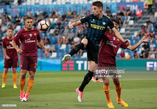Andrea Pinamonti of FC Internazionale Milano competes for the ball with Stefano Ciavattini of As Roma during the Primavera TIM Playoffs match between...