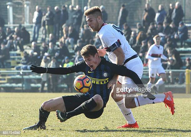 Andrea Pinamonti of FC Internazionale Milano is challenged during the Primavera Tim juvenile match between FC Internazionale and Genoa CFC at Stadio...
