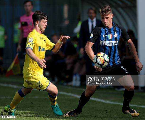 Andrea Pinamonti of FC Internazionale Milano is challenged during the Serie A Primavera match between FC Internazionale U19 and Chievo Verona U19 at...