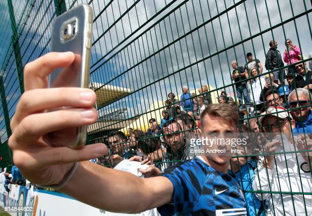 Andrea Pinamonti of FC Internazionale Milano signs autographs for fans at the end of the FC Internazionale training session on July 15 2017 in...