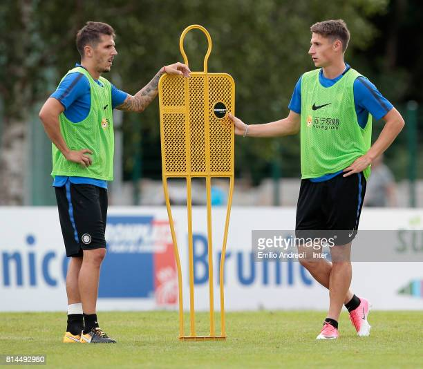 Andrea Pinamonti of FC Internazionale Milano speaks to his teammate Stevan Jovetic during a FC Internazionale training session on July 14 2017 in...
