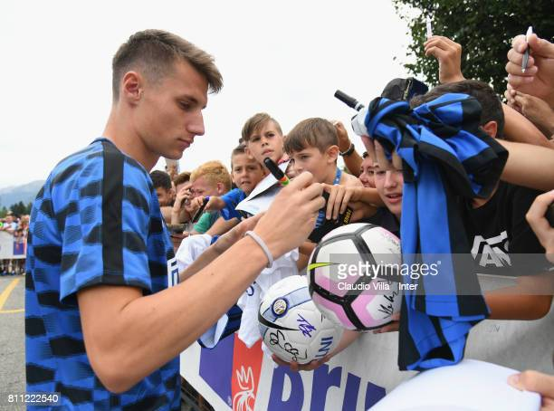 Andrea Pinamonti of FC Internazionale signs autographs for fans after the FC Internazionale training session on July 9 2017 in Reischach near Bruneck...