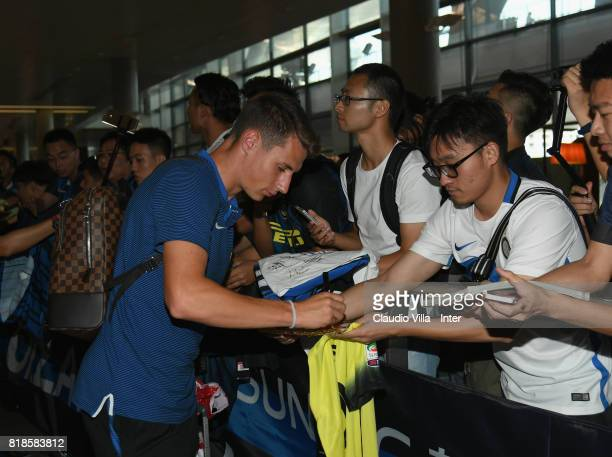 Andrea Pinamonti of FC Internazionale signs autographs for fans at Nanjing International Airport on July 19 2017 in Nanjing China