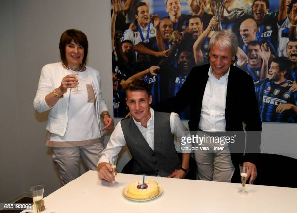 Andrea Pinamonti of FC Internazionale with his parents celebrates his 18th birthday on May 19 2017 in Milan Italy