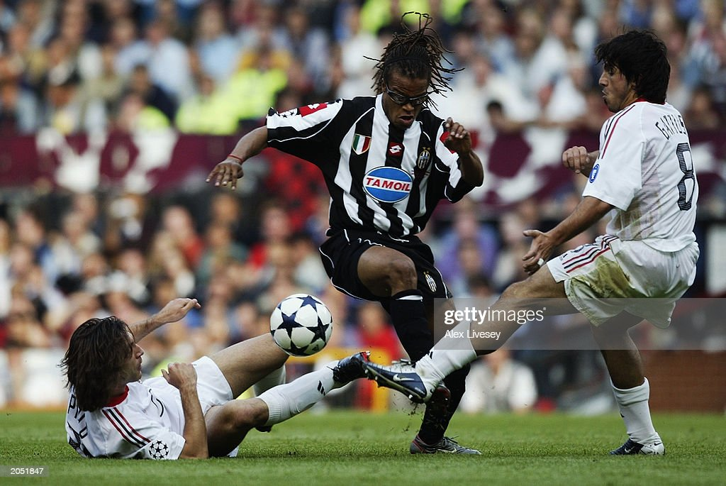 Andrea Pirlo and Gennaro Gattuso of AC Milan attempt to tackle <a gi-track='captionPersonalityLinkClicked' href=/galleries/search?phrase=Edgar+Davids&family=editorial&specificpeople=213130 ng-click='$event.stopPropagation()'>Edgar Davids</a> of Juventus during the UEFA Champions League Final match between Juventus FC and AC Milan on May 28, 2003 at Old Trafford in Manchester, England. AC Milan won the final 3-2 on penalties.