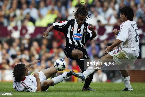 Andrea Pirlo and Gennaro Gattuso of AC Milan attempt to tackle Edgar Davids of Juventus during the UEFA Champions League Final match between Juventus...