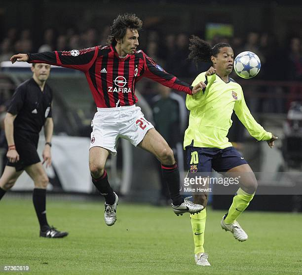Andrea Pirlo of AC Milan challenges Ronaldinho of Barcelona during the UEFA Champions League Semi Final first leg match between AC Milan and...
