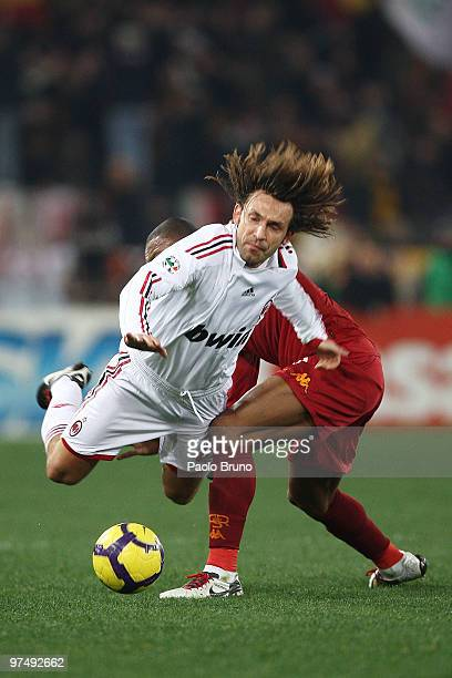 Andrea Pirlo of AC Milan takes a tumble during the Serie A match between AS Roma and AC Milan at Stadio Olimpico on March 6 2010 in Rome Italy