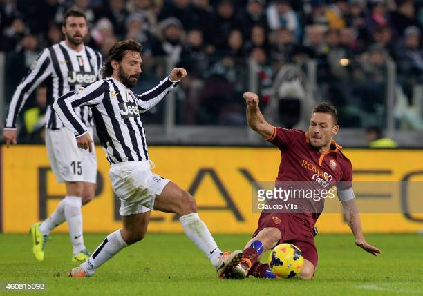 Andrea Pirlo of FC Juventus and Francesco Totti of AS Roma compete for the ball during the Serie A match between Juventus and AS Roma at Juventus...