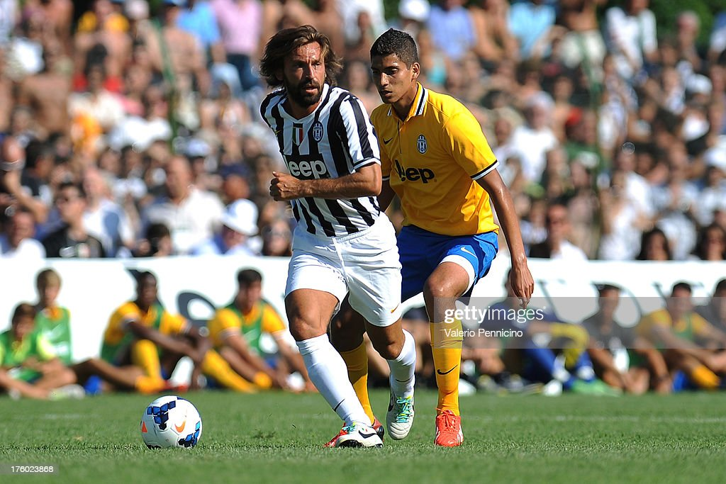 Andrea Pirlo (L) of FC Juventus in action during the pre-season friendly match between FC Juventus A and FC Juventus B on August 11, 2013 in Villar Perosa near Pinerolo, Italy.
