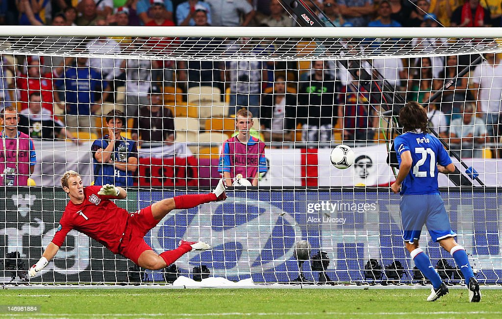 Andrea Pirlo of Italy chips the ball in the penalty shootout past Joe Hart of England during the UEFA EURO 2012 quarter final match between England...