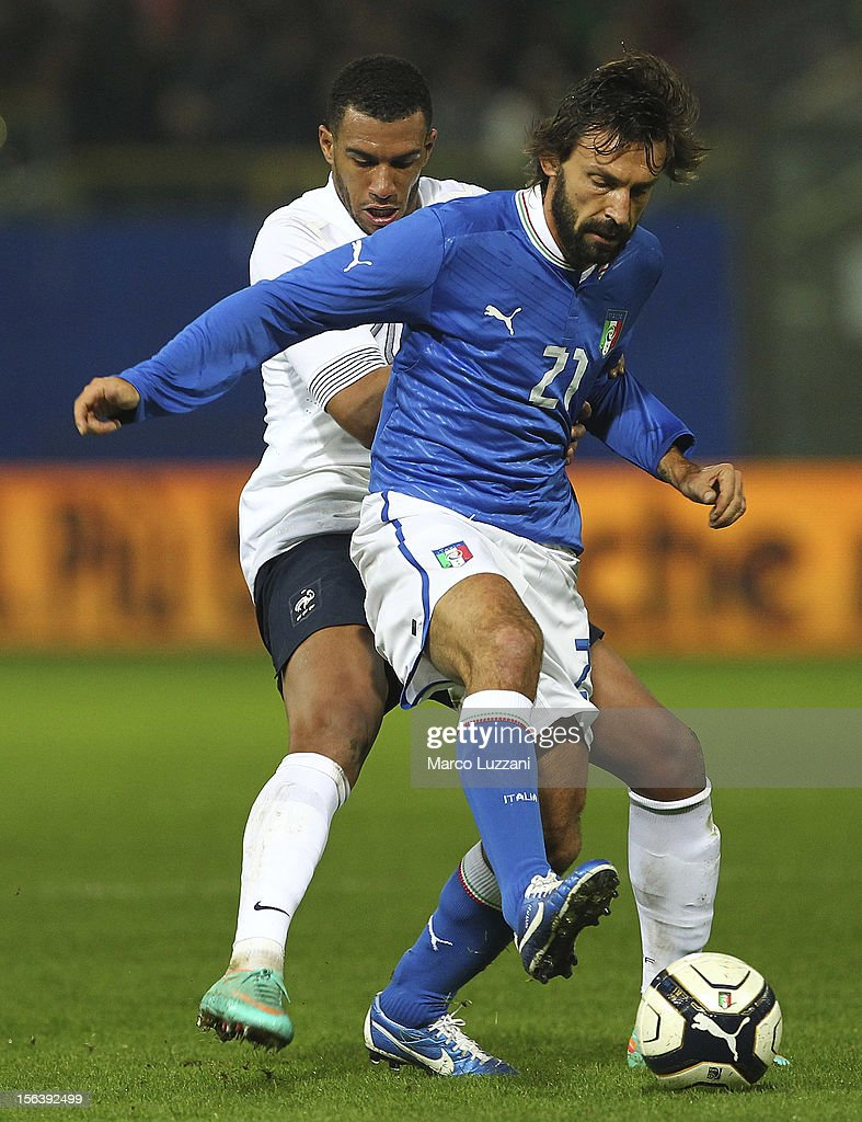 Andrea Pirlo (R) of Italy competes for the ball with Etienne Capoue (L) of France during the international friendly match between Italy and France at Stadio Ennio Tardini on November 14, 2012 in Parma, Italy.