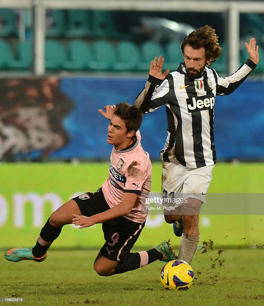<a gi-track='captionPersonalityLinkClicked' href=/galleries/search?phrase=Andrea+Pirlo&family=editorial&specificpeople=198835 ng-click='$event.stopPropagation()'>Andrea Pirlo</a> (R) of Juventus and <a gi-track='captionPersonalityLinkClicked' href=/galleries/search?phrase=Paulo+Dybala&family=editorial&specificpeople=9572043 ng-click='$event.stopPropagation()'>Paulo Dybala</a> of Palermo compete for the ball during the Serie A match between US Citta di Palermo v Juventus FC at Stadio Renzo Barbera on December 9, 2012 in Palermo, Italy.