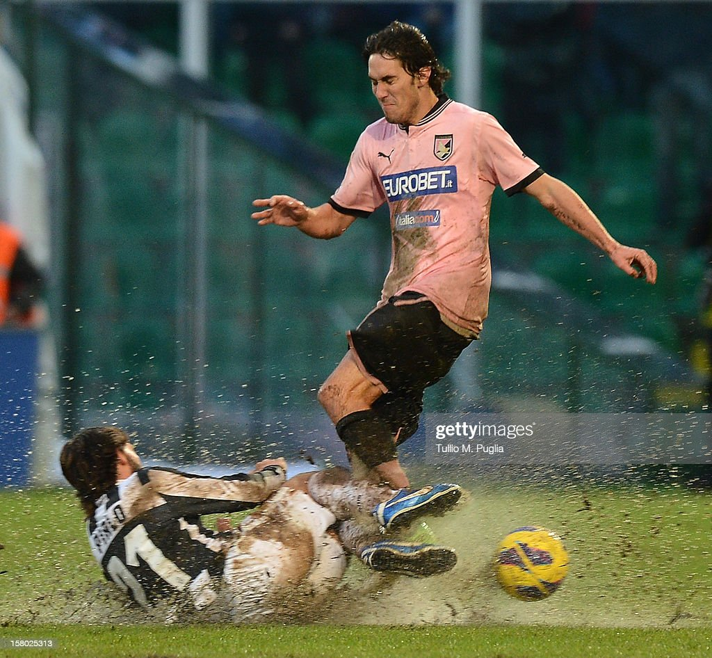 <a gi-track='captionPersonalityLinkClicked' href=/galleries/search?phrase=Andrea+Pirlo&family=editorial&specificpeople=198835 ng-click='$event.stopPropagation()'>Andrea Pirlo</a> (L) of Juventus and Santiago Garcia of Palermo compete for the ball during the Serie A match between US Citta di Palermo v Juventus FC at Stadio Renzo Barbera on December 9, 2012 in Palermo, Italy.