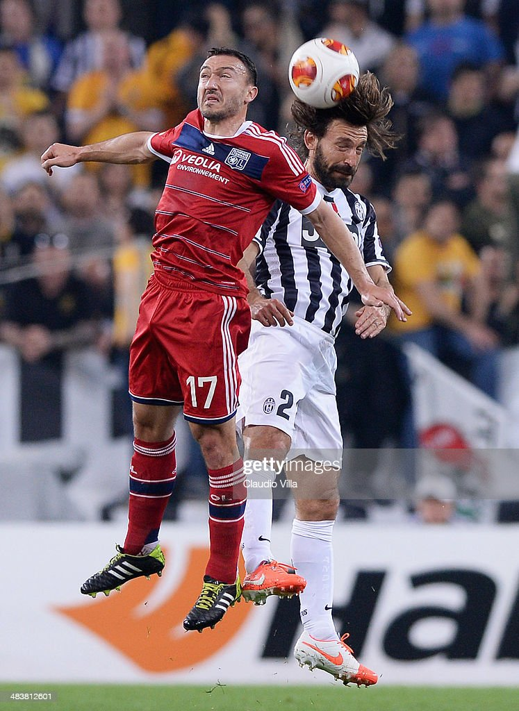 Andrea Pirlo of Juventus and Steed Malbranque of Lyon #17 compete for the ball during the UEFA Europa League quarter final match between Juventus and Olympique Lyonnais at Juventus Arena on April 10, 2014 in Turin, Italy.