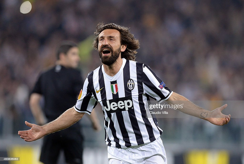 Andrea Pirlo of Juventus celebrates scoring the first goal during the UEFA Europa League quarter final match between Juventus and Olympique Lyonnais at Juventus Arena on April 10, 2014 in Turin, Italy.