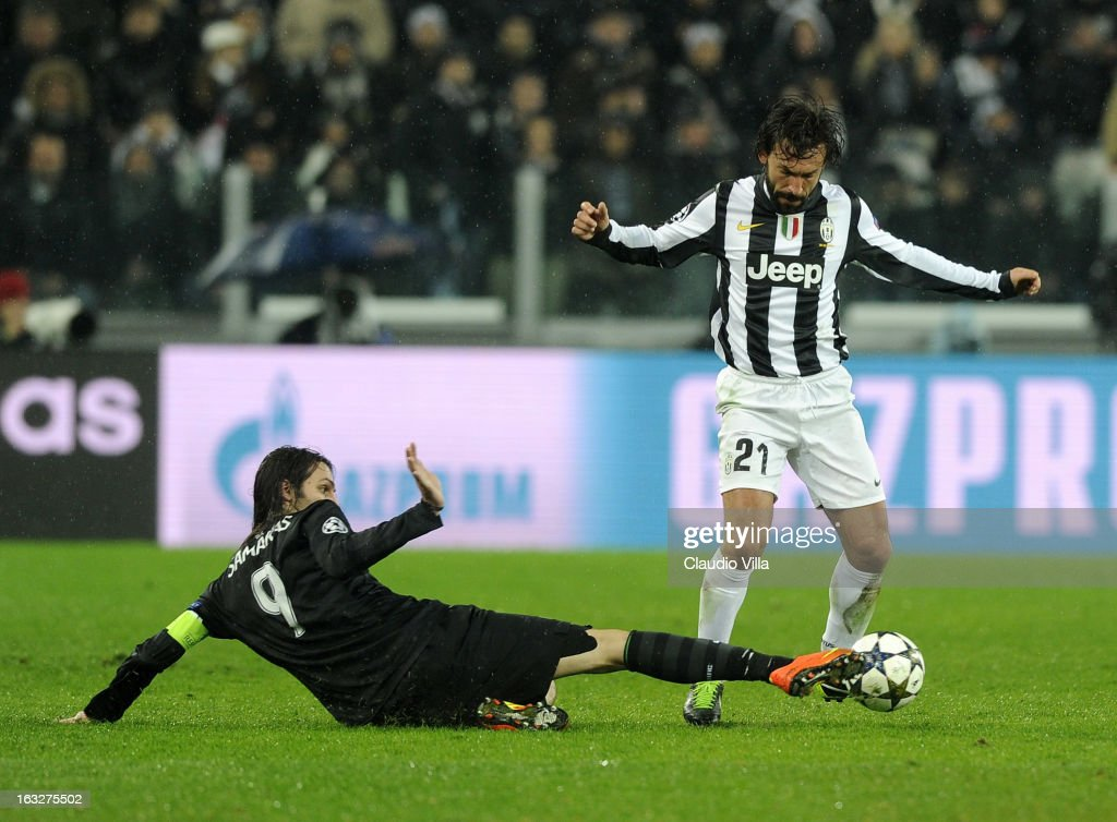 Andrea Pirlo of Juventus duels for the ball with Giorgios Samaras of Celtic #9 during the Champions League round of 16 second leg match between Juventus and Celtic at Juventus Arena on March 6, 2013 in Turin, Italy.