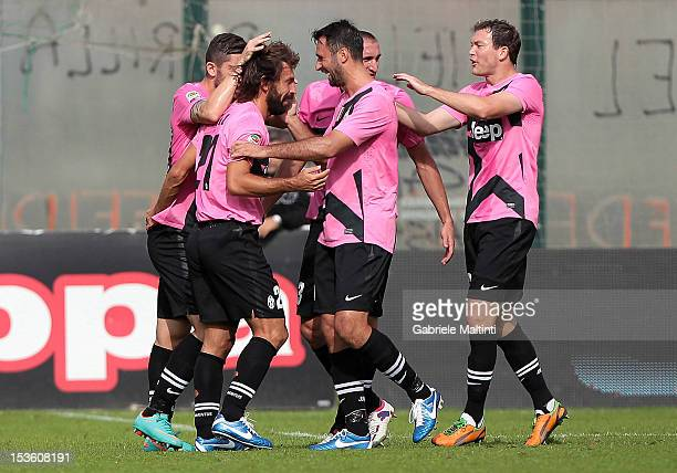 Andrea Pirlo of Juventus FC celebrates with teammates after scoring a goal during the Serie A match between AC Siena and FC Juventus at Stadio...