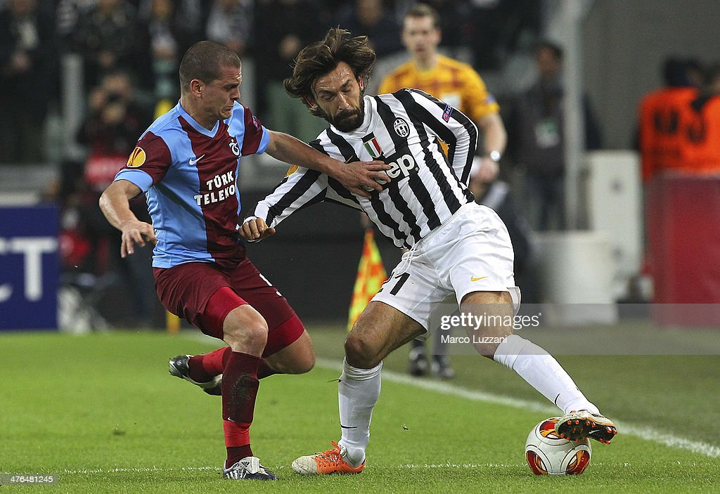 <a gi-track='captionPersonalityLinkClicked' href=/galleries/search?phrase=Andrea+Pirlo&family=editorial&specificpeople=198835 ng-click='$event.stopPropagation()'>Andrea Pirlo</a> (R) of Juventus FC competes for the ball with <a gi-track='captionPersonalityLinkClicked' href=/galleries/search?phrase=Alexandru+Bourceanu&family=editorial&specificpeople=6597771 ng-click='$event.stopPropagation()'>Alexandru Bourceanu</a> (L) of AS Trabzonspor during the UEFA Europa League Round of 32 match between Juventus and AS Trabzonspor at Juventus Arena on February 20, 2014 in Turin, Italy.