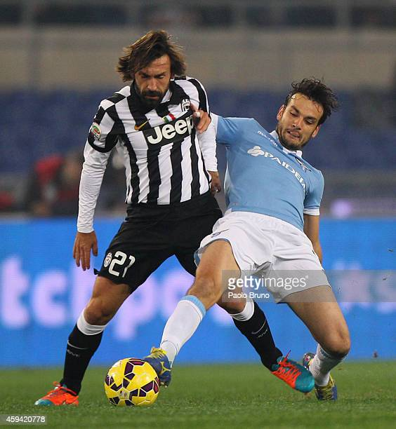 Andrea Pirlo of Juventus FC competes for the ball with Marco Parolo of SS Lazio during the Serie A match between SS Lazio and Juventus FC at Stadio...