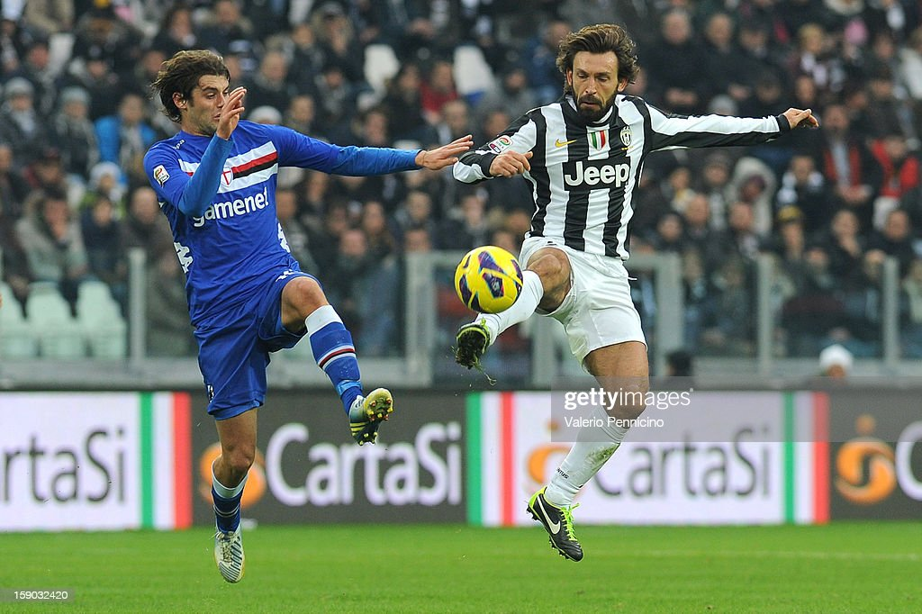 Andrea Pirlo (R) of Juventus FC in action against Andrea Poli of UC Sampdoria during the Serie A match between Juventus FC and UC Sampdoria at Juventus Arena on January 6, 2013 in Turin, Italy.