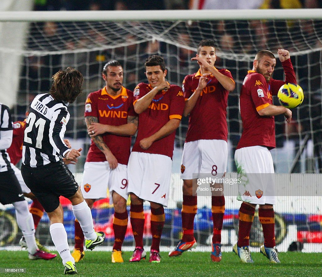 Andrea Pirlo (L) of Juventus FC kicks the ball as the defensive wall reacts during the Serie A match between AS Roma and Juventus FC at Stadio Olimpico on February 16, 2013 in Rome, Italy.