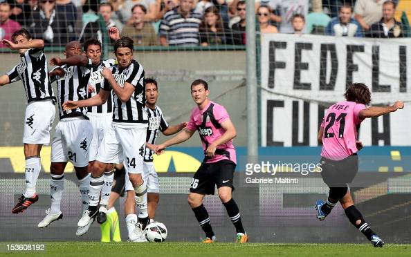 Andrea Pirlo of Juventus FC scores the opening goal during the Serie A match between AC Siena and FC Juventus at Stadio Artemio Franchi on October 7...