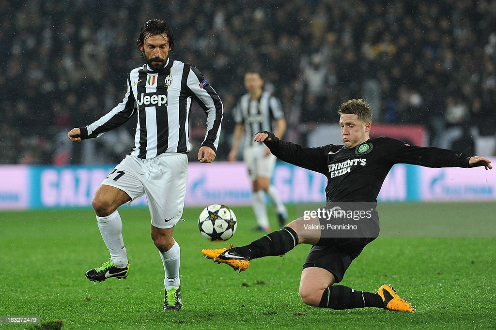 Andrea Pirlo (L) of Juventus is challenged by Kris Commons of Celtic during the UEFA Champions League round of 16 second leg match between Juventus and Celtic at Juventus Arena on March 6, 2013 in Turin, Italy.