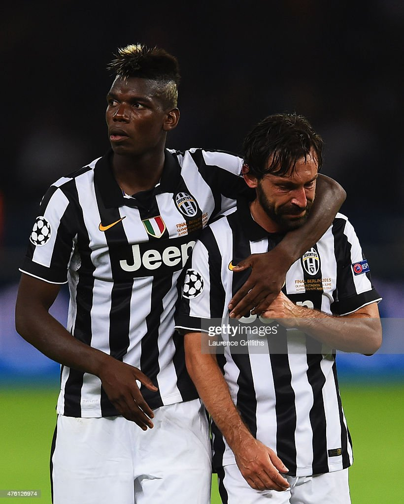 <a gi-track='captionPersonalityLinkClicked' href=/galleries/search?phrase=Andrea+Pirlo&family=editorial&specificpeople=198835 ng-click='$event.stopPropagation()'>Andrea Pirlo</a> of Juventus is consoled by <a gi-track='captionPersonalityLinkClicked' href=/galleries/search?phrase=Paul+Pogba&family=editorial&specificpeople=5805302 ng-click='$event.stopPropagation()'>Paul Pogba</a> after the UEFA Champions League Final between Juventus and FC Barcelona at Olympiastadion on June 6, 2015 in Berlin, Germany.