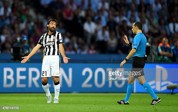 Andrea Pirlo of Juventus reacts with referee Cuneyt Cakir during the UEFA Champions League Final between Juventus and FC Barcelona at Olympiastadion...