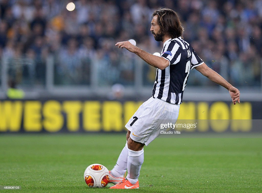 Andrea Pirlo of Juventus scores the first goal during the UEFA Europa League quarter final match between Juventus and Olympique Lyonnais at Juventus Arena on April 10, 2014 in Turin, Italy.