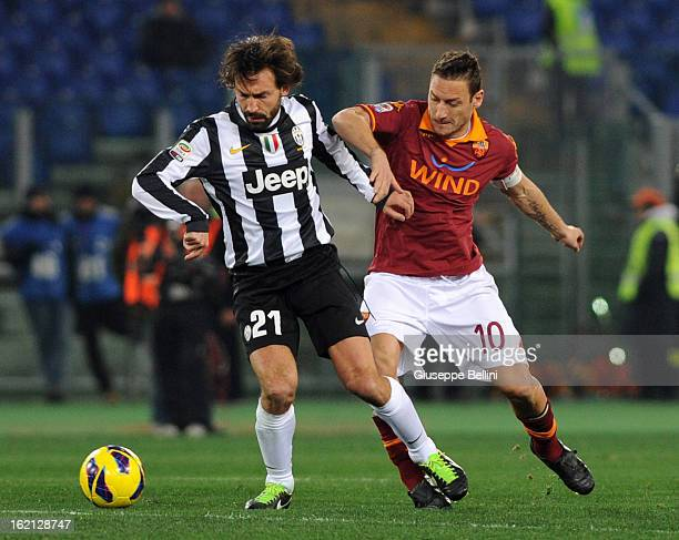 Andrea Pirlo of Juventus shields the ball from Francesco Totti of Roma during the Serie A match between AS Roma and Juventus FC at Stadio Olimpico on...