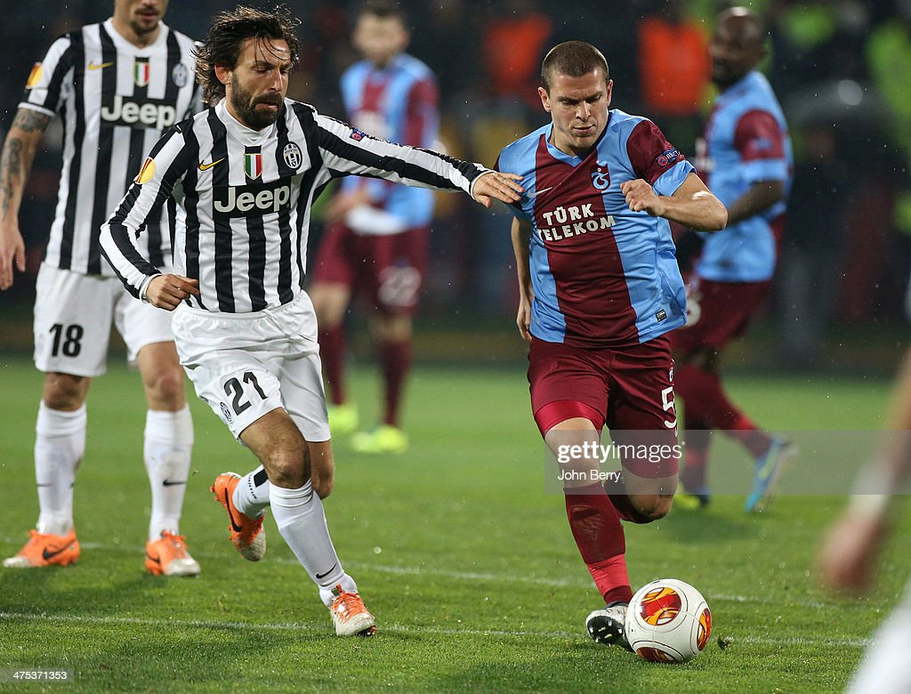 <a gi-track='captionPersonalityLinkClicked' href=/galleries/search?phrase=Andrea+Pirlo&family=editorial&specificpeople=198835 ng-click='$event.stopPropagation()'>Andrea Pirlo</a> of Juventus Turin and <a gi-track='captionPersonalityLinkClicked' href=/galleries/search?phrase=Alexandru+Bourceanu&family=editorial&specificpeople=6597771 ng-click='$event.stopPropagation()'>Alexandru Bourceanu</a> of Trabzonspor in action during the UEFA Europa League round of 32 match between AS Trabzonspor and Juventus Turin at Huseyin Avni Aker Stadium on February 27, 2014 in Trabzon, Turkey.