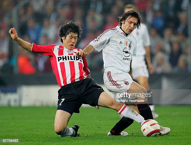 Andrea Pirlo of Milan challenges Ji Sung Park of PSV during the UEFA Champions League Semi Final 2nd Leg match between PSV Eindhoven and AC Milan...