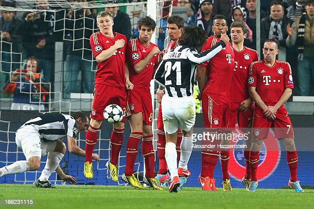 Andrea Pirlo of Turin kicks a free kick during the UEFA Champions League quarterfinal second leg match between Juventus and FC Bayern Muenchen at...