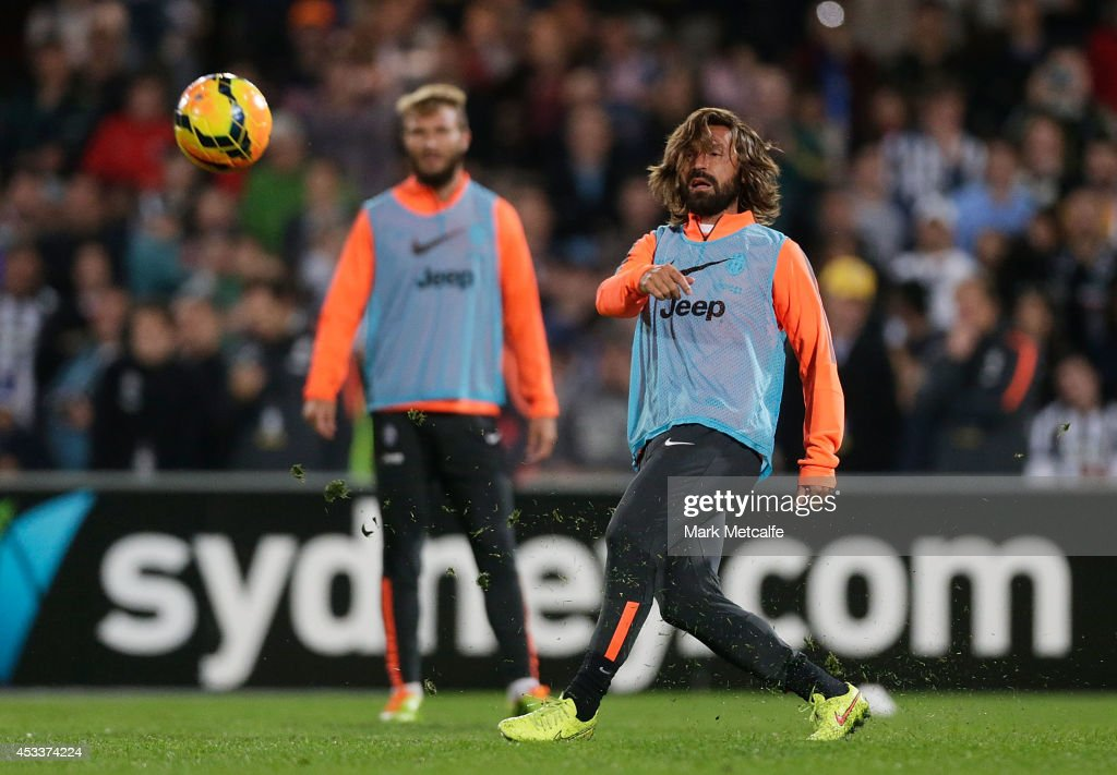 Andrea Pirlo passes during a Juventus training session at WIN Jubilee Stadium on August 9, 2014 in Sydney, Australia.