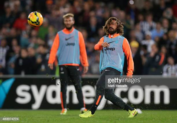 Andrea Pirlo passes during a Juventus training session at WIN Jubilee Stadium on August 9 2014 in Sydney Australia