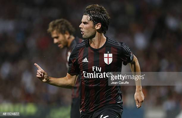 Andrea Poli of AC Milan celebrates his goal during the friendly match between Olympic Lyonnais and Milan AC at Stade de Gerland on July 18 2015 in...