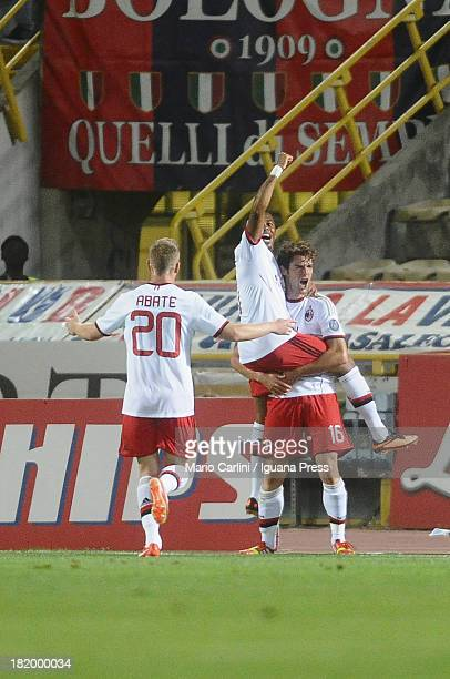 Andrea Poli of AC Milan celebrates with his teamates after scoring his team's first goal during the Serie A match between Bologna and AC Milan at...