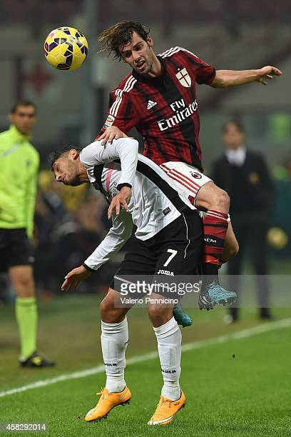 Andrea Poli of AC Milan clashes with Achraf Lazaar of US Citta di Palermo during the Serie A match between AC Milan and US Citta di Palermo at Stadio...
