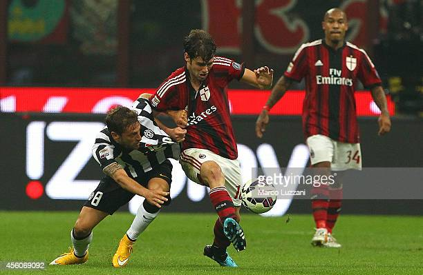 Andrea Poli of AC Milan competes for the ball with Claudio Marchisio of Juventus FC during the Serie A match between AC Milan and Juventus FC at...