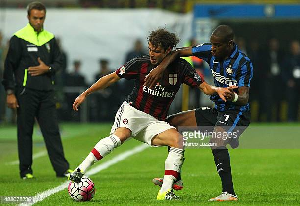 Andrea Poli of AC Milan competes for the ball with Geoffrey Kondogbia of FC Internazionale Milano during the Serie A match between FC Internazionale...