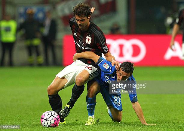 Andrea Poli of AC Milan competes for the ball with Mario Rui Silva Duarte of Empoli FC during the Serie A match between AC Milan and Empoli FC at...