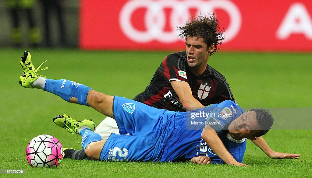 Andrea Poli of AC Milan competes for the ball with Mario Rui Silva Duarte of Empoli FC during the Serie A match between AC Milan and Empoli FC at Stadio Giuseppe Meazza on August 29, 2015 in Milan, Italy.