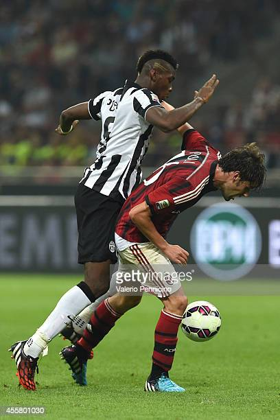 Andrea Poli of AC Milan competes with Paul Pogba of Juventus FC during the Serie A match between AC Milan and Juventus FC at Stadio Giuseppe Meazza...