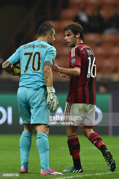 Andrea Poli of AC Milan discutes with Stefano Sorrentino of US Citta di Palermo during the Serie A match between AC Milan and US Citta di Palermo at...