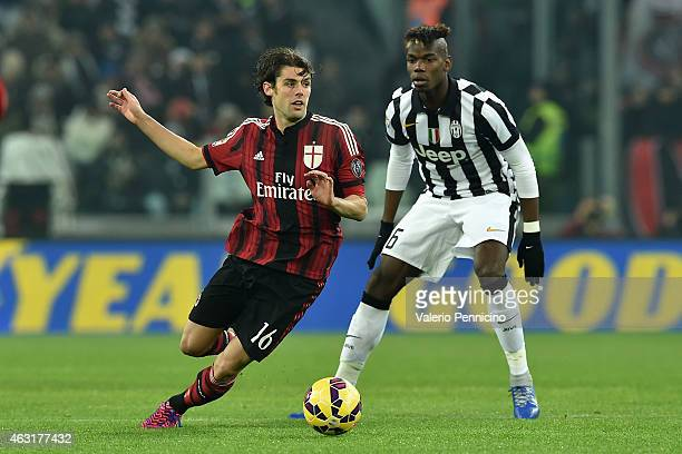 Andrea Poli of AC Milan in action against Paul Pogba of AC Milan during the Serie A match between Juventus FC and AC Milan at Juventus Arena on...
