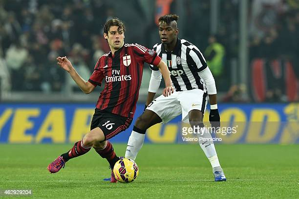 Andrea Poli of AC Milan in action against Paul Pogba of Juventus FC during the Serie A match between Juventus FC and AC Milan at Juventus Arena on...